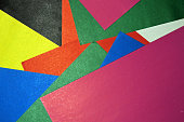 Colorful background from paper of different colors