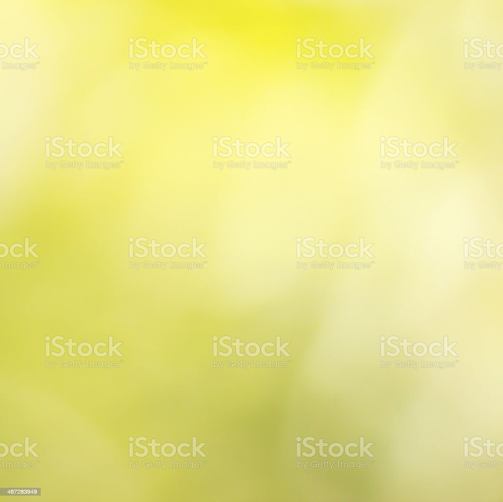 A colorful background image of blurred yellow and white stock photo