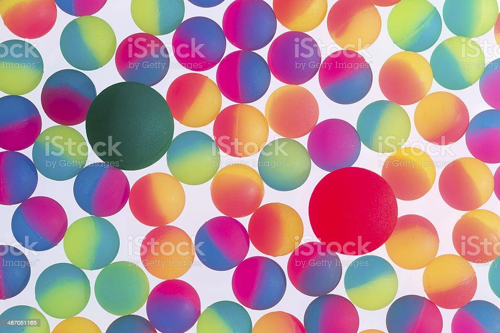Colorful background of bicolor plastic balls stock photo
