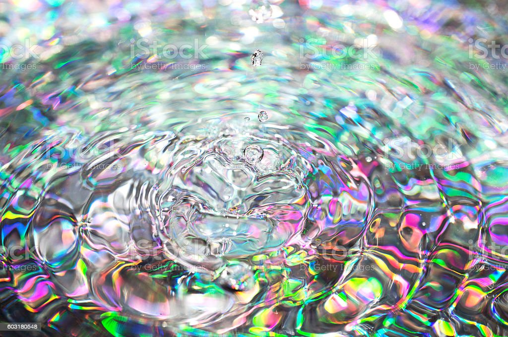 Colorful background with ripples and drops stock photo