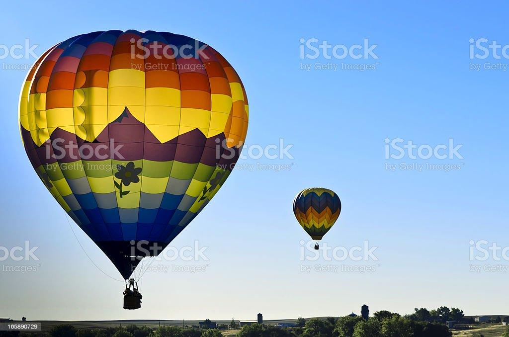 Colorful Backlit Hot Air Balloons Launcing at Sunrise royalty-free stock photo