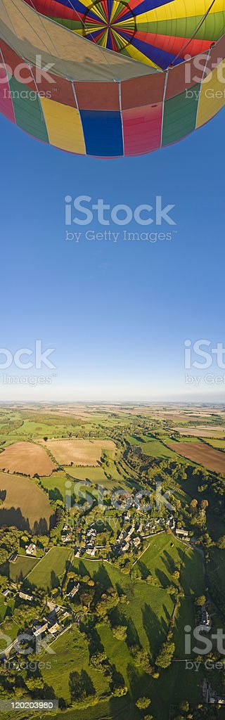 Colorful balloon sunlit countryside royalty-free stock photo