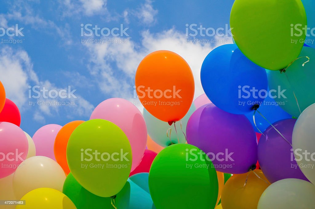 Colorful balloons against a blue sky stock photo