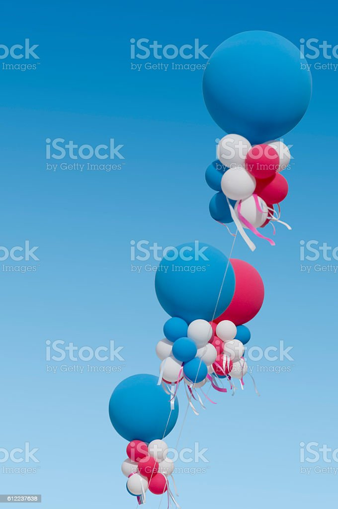 Colorful balloons and blue sky stock photo