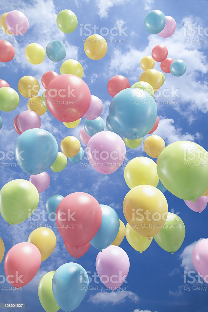Colorful balloons flying in the air stock photo