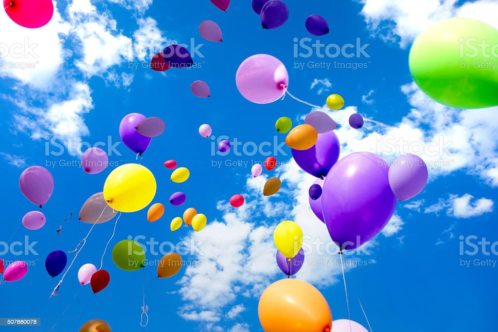 Colorful Balloons flying in the sky stock photo