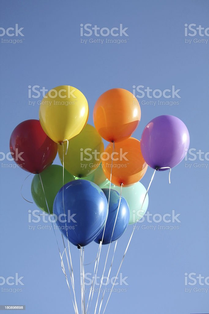 Colorful balloons in a clear blue sky royalty-free stock photo