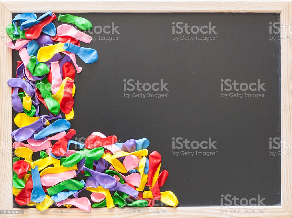 Colorful balloons on a blackboard stock photo