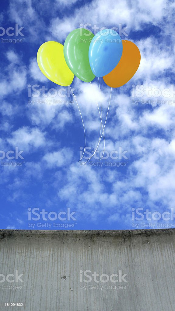 colorful balloons with blue sky over wall royalty-free stock photo