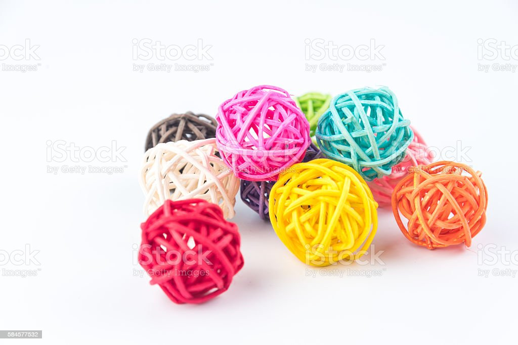 colorful balls of hemp twine on white background stock photo