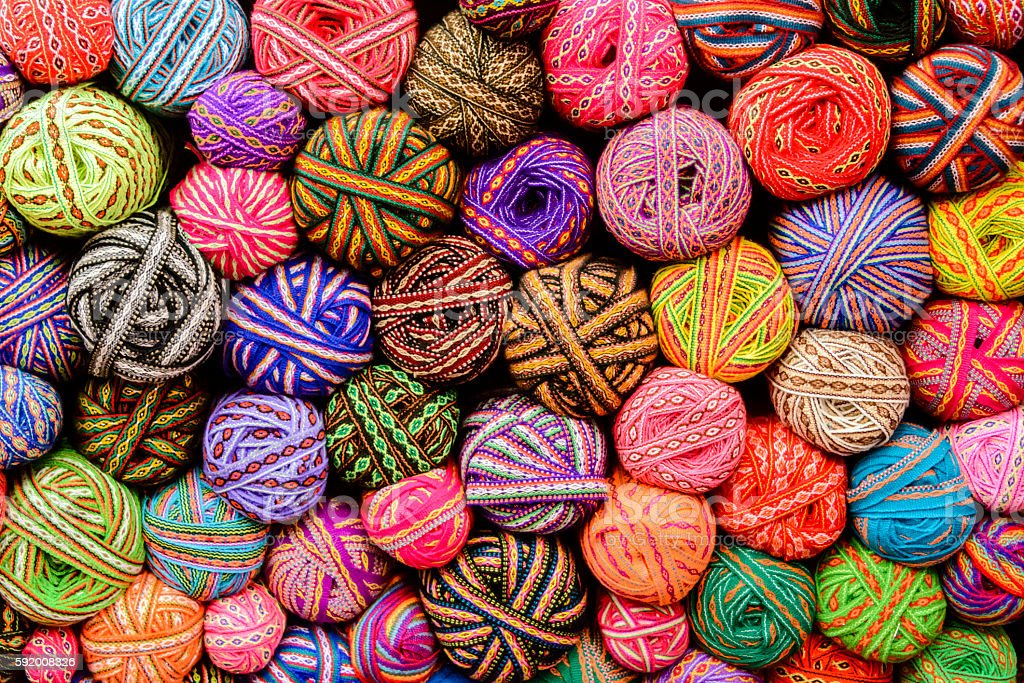 Colorful balls of yarn and ribbons stock photo