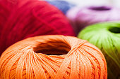Colorful balls of yarn background, close-up