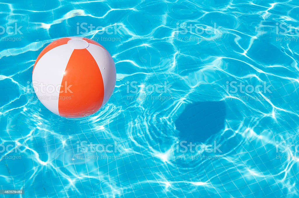 Unique Pool Water With Beach Ball In Swimming Vertical Stock Photo