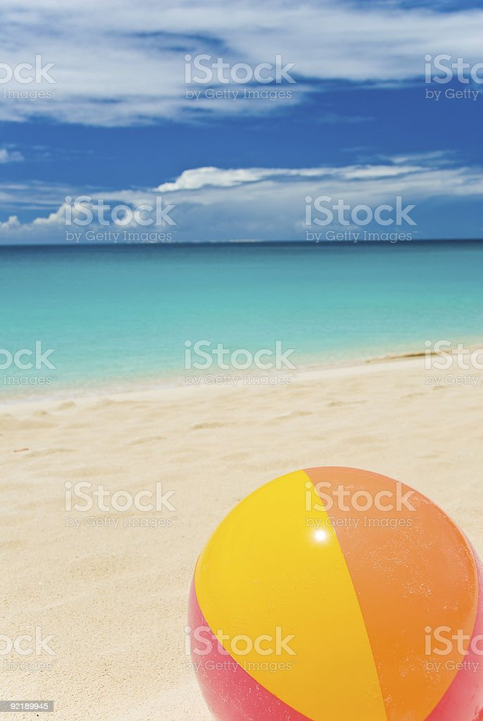 Colorful Beach Ball Resting  on the Seashore royalty-free stock photo