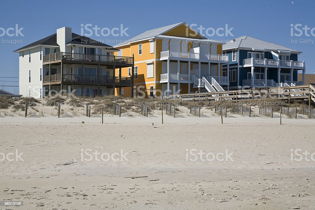 colorful beach houses stock photo