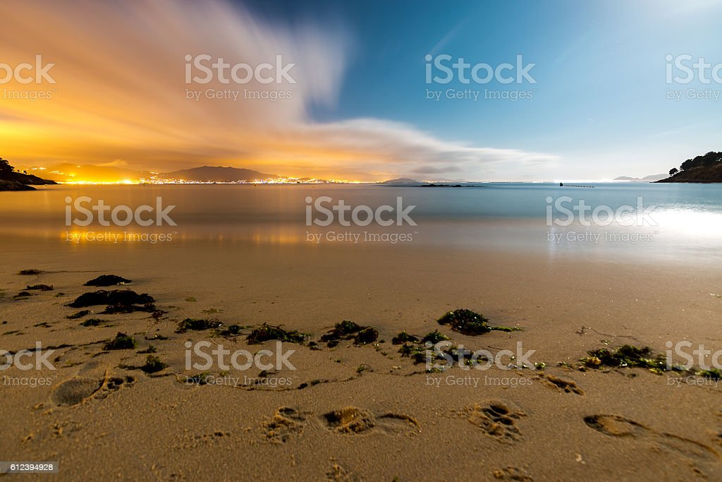 Colorful beach scinery at night stock photo