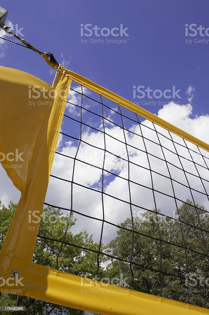 Colorful beach volley net with blue sky and clouds behind royalty-free stock photo