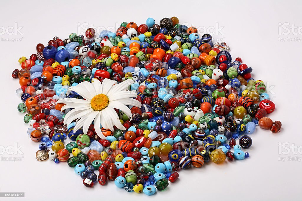 Colorful beads and daisy royalty-free stock photo