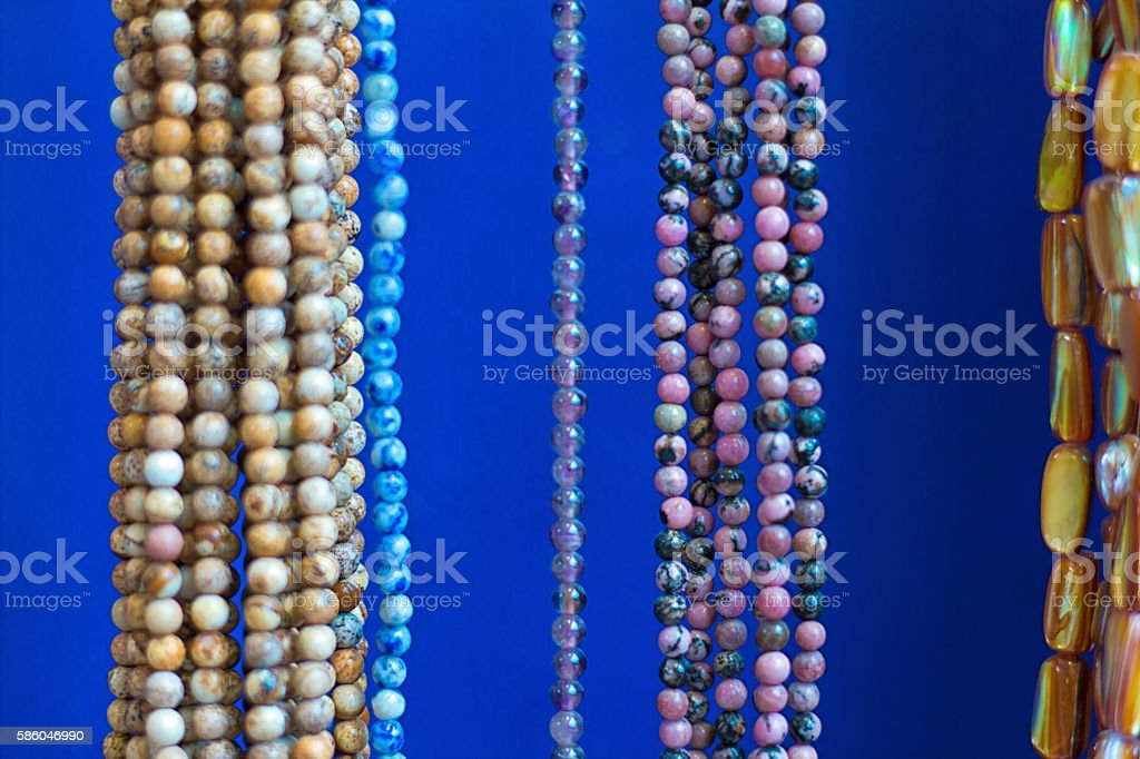 Colorful Beads and Necklaces Hanging in Shop (Close-Up) stock photo