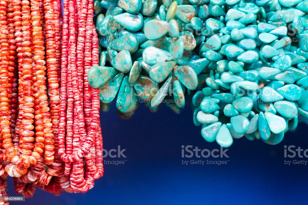 Colorful Beads and Necklaces Hanging in Shop Window (Close-Up) stock photo