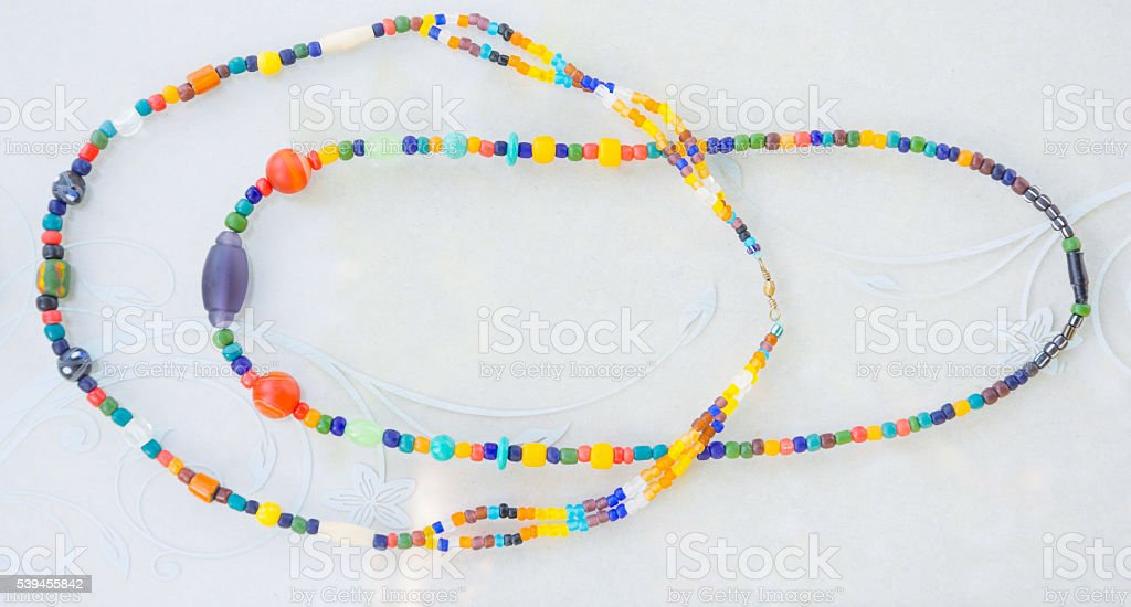 Colorful Beads knecklace in art-mirror box , isolated white background stock photo