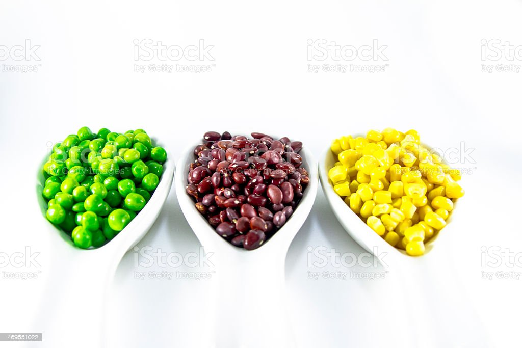 colorful beans in a white bowl stock photo