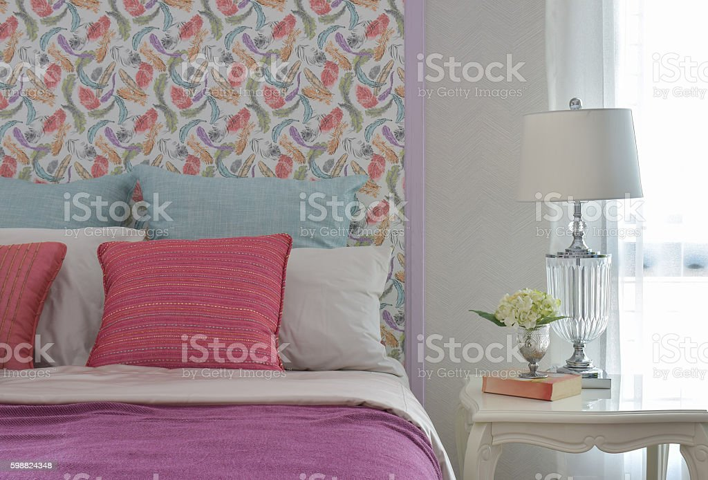Colorful bedding style with beautiful pattern headboard stock photo