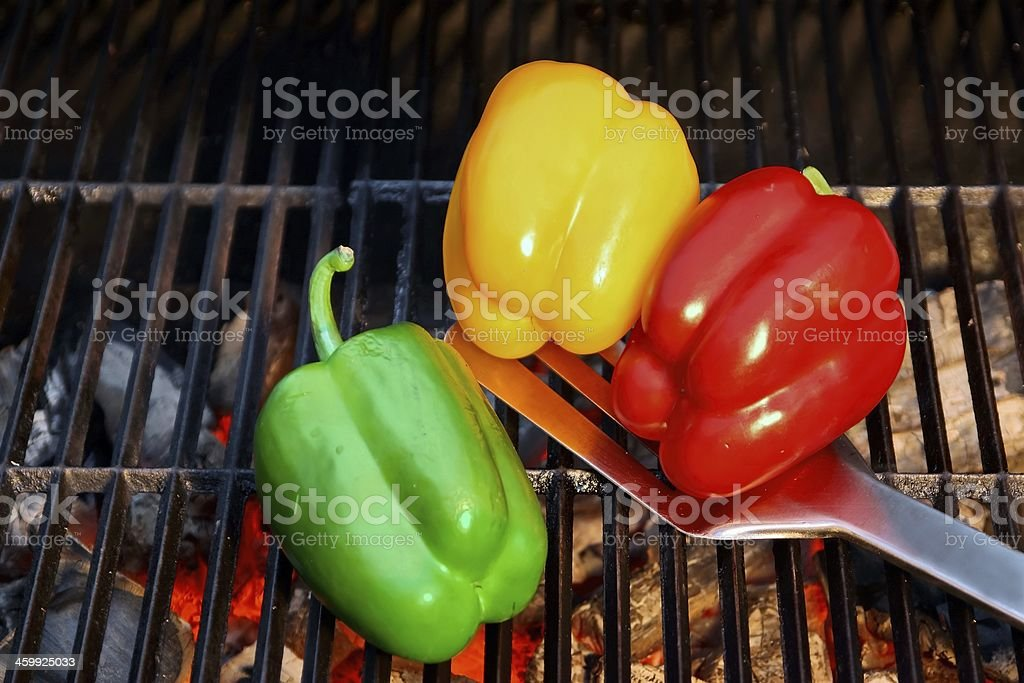 Colorful Bell pepper on the BBQ cast iron Grill stock photo