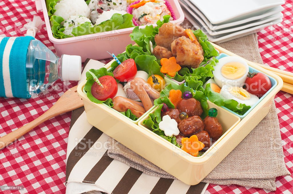 Colorful bento box on a red checked tablecloth stock photo