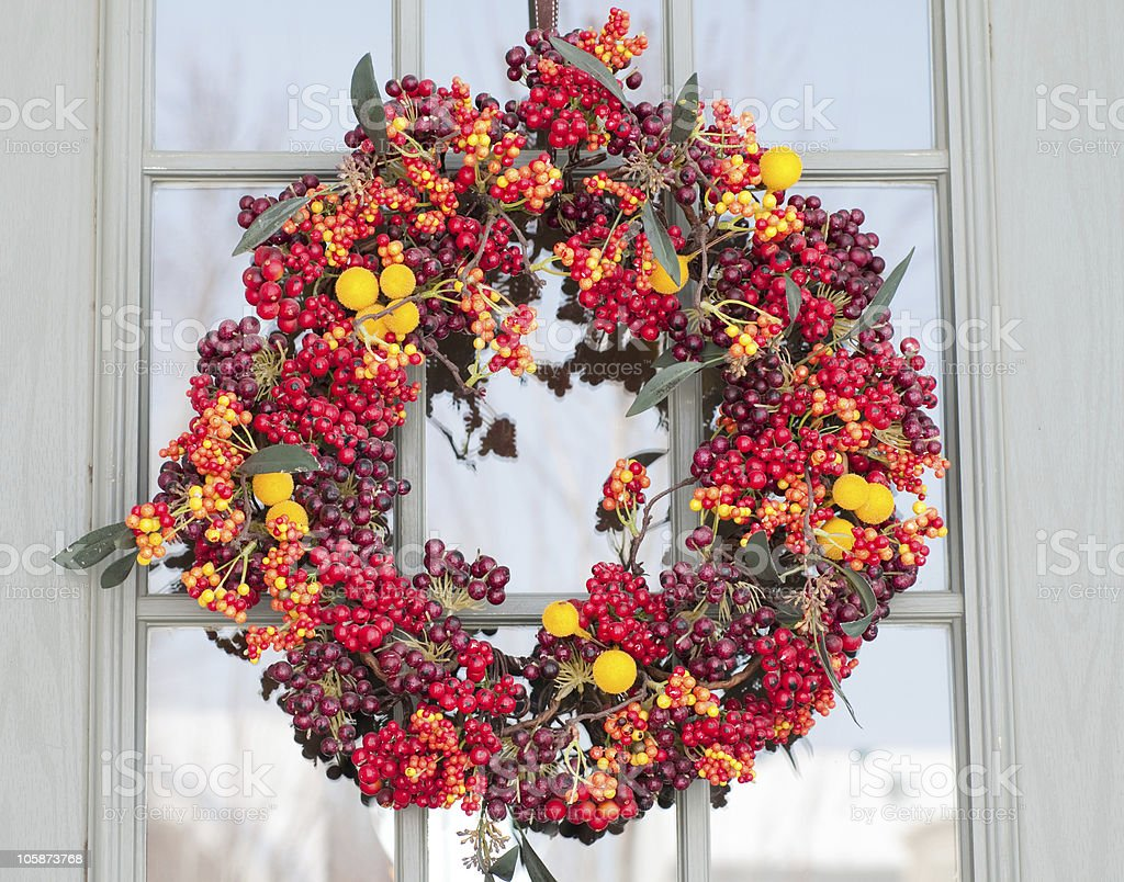 Colorful Berry Wreath on a Door royalty-free stock photo