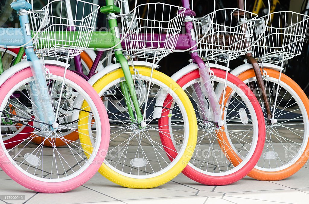 Colorful bicycles for sale at a shop stock photo