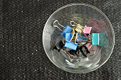 Colorful binder clips in a container