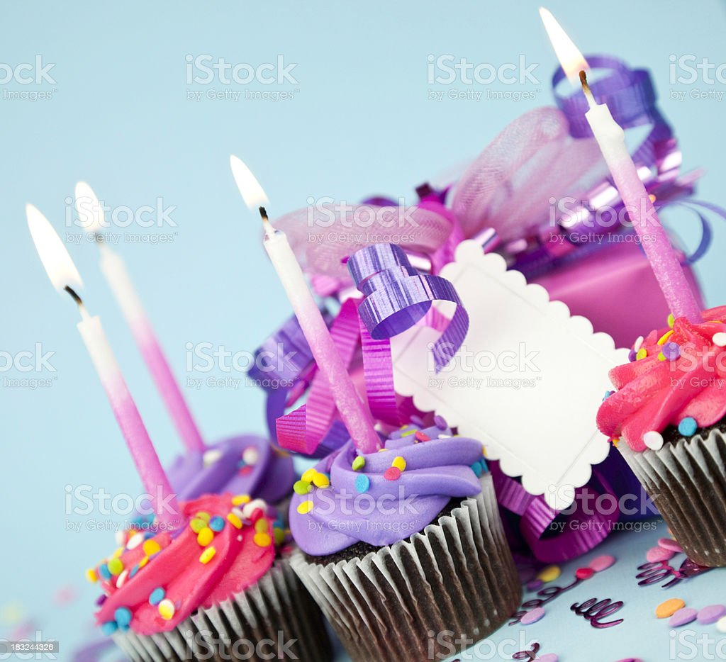 Colorful Birthday Gifts with Cupcakes royalty-free stock photo