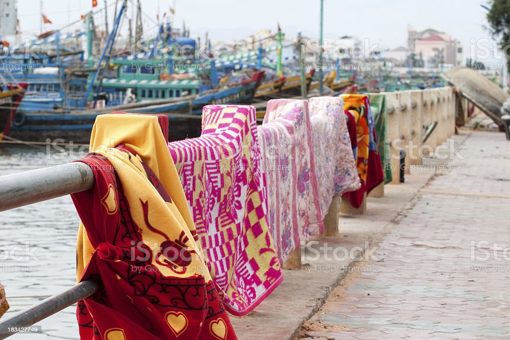 colorful blankets on background of harbor Vietnam Phan Thiet stock photo