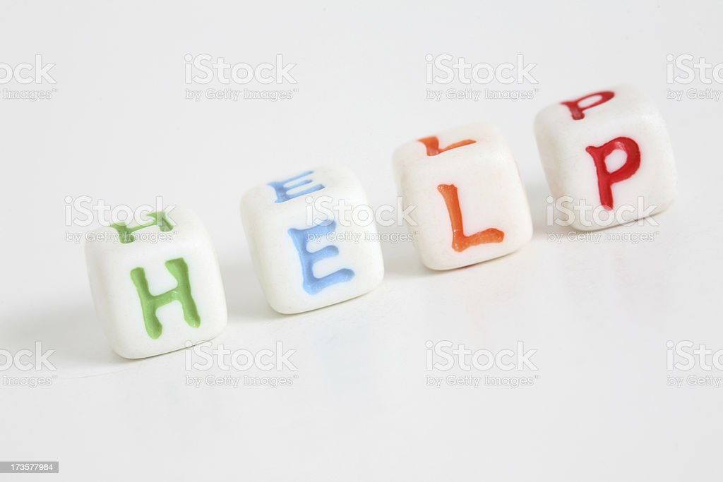 Colorful Block Letters Spelling Out Help royalty-free stock photo