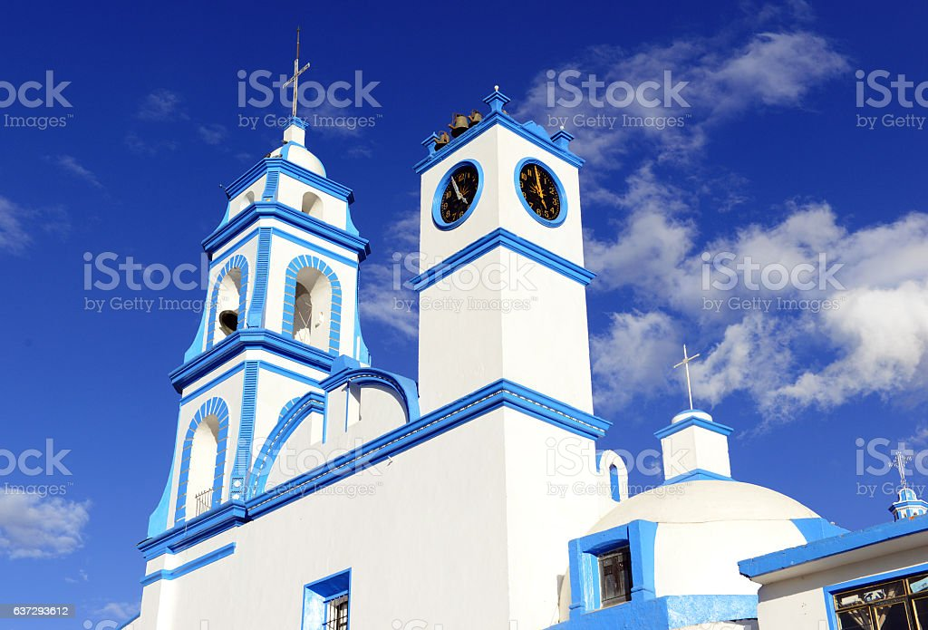 Colorful Blue and white Church with blue sky background, Mexico stock photo