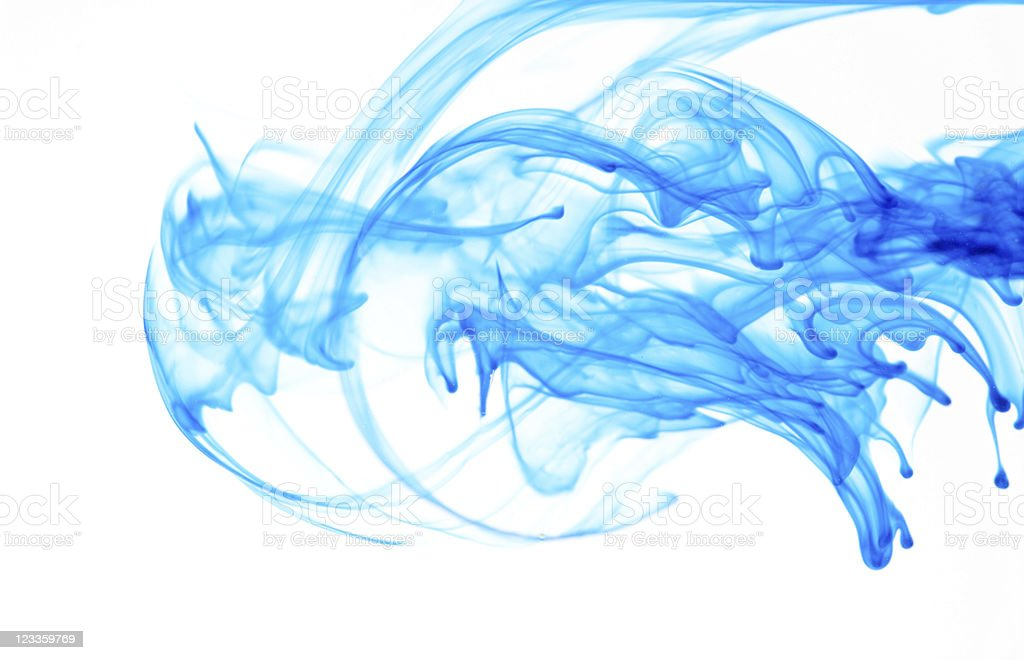 Colorful blue ink swirls on a white background stock photo