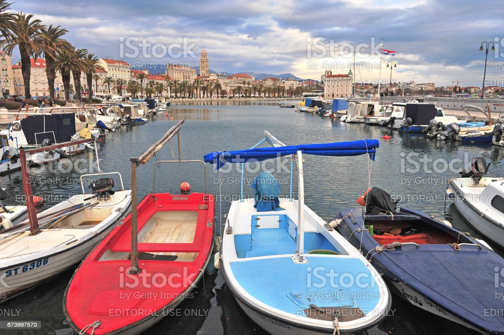 Colorful boats and Split old town, Croatia stock photo