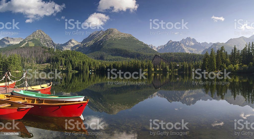 Colorful boats on Strbske lake in high Tatras - Slovakia stock photo