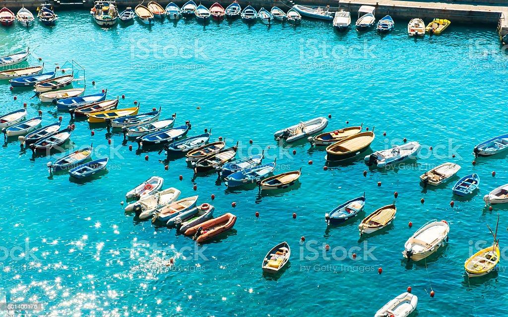 Colorful Boats, Sparkling Sea at Vernazza Harbor stock photo