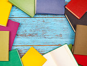 colorful books on a wooden background