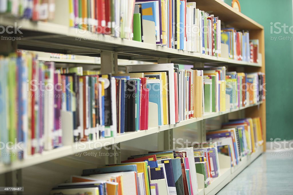 Colorful books on the bookshelf in library stock photo