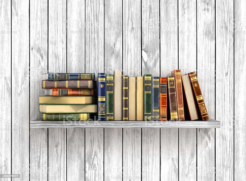 Colorful books on the white wood background. stock photo
