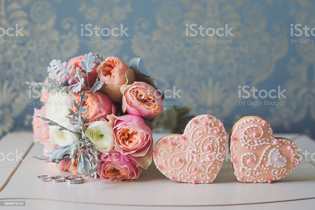 Colorful bouquet, wedding rings and two decorated beautiful honey cakes. stock photo