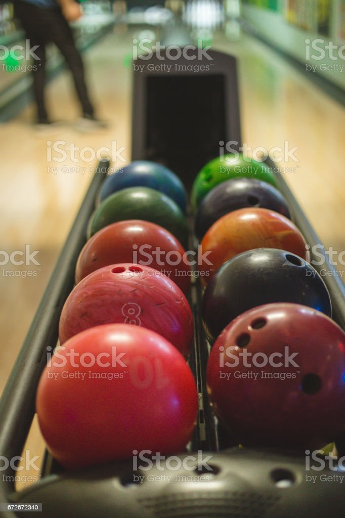 Colorful bowling balls in a row stock photo