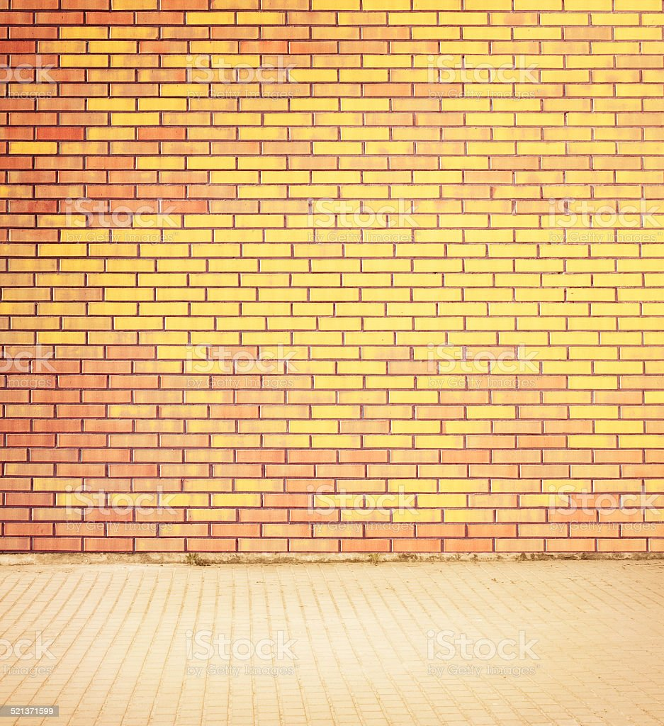 Colorful brick wall texture with walkway. stock photo