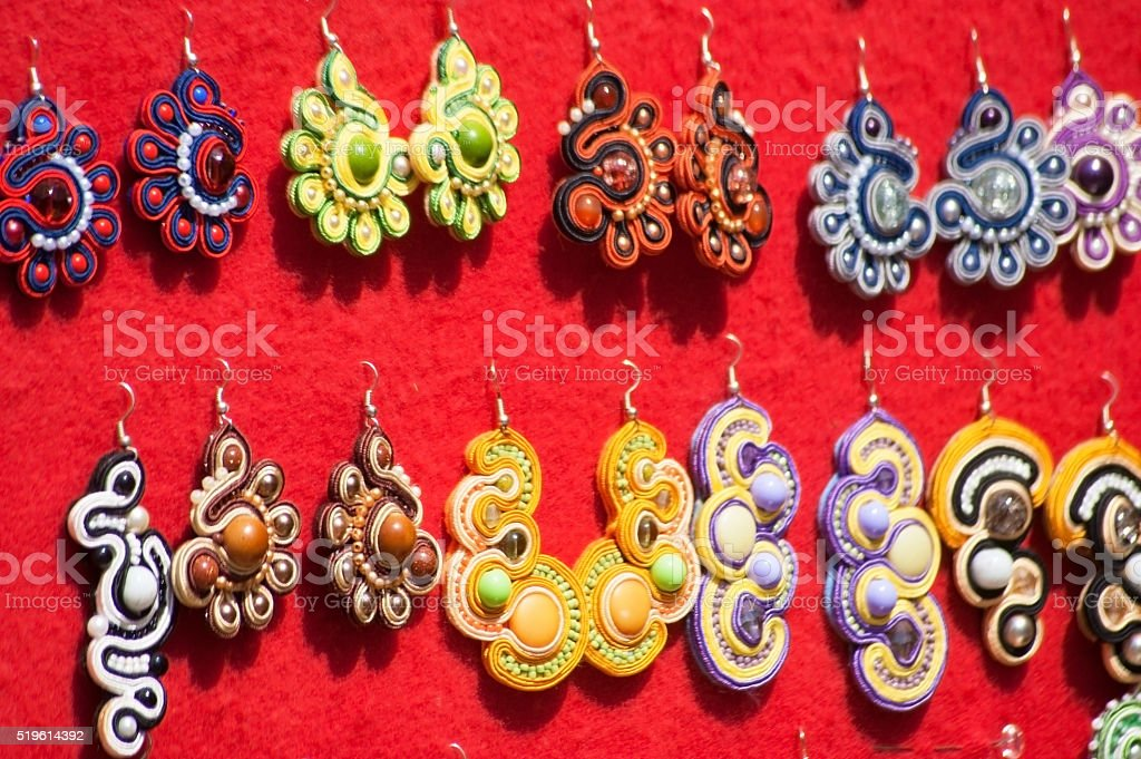 Colorful brooches with modeling clay stock photo