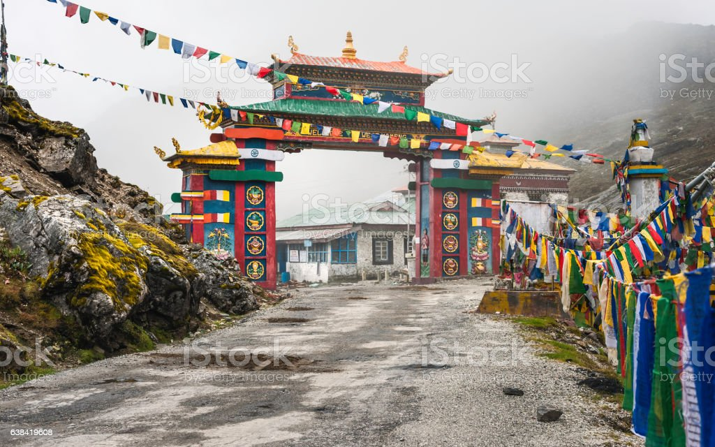 Colorful Buddhist gateway into Tawang, Arunachal Pradesh, India. stock photo