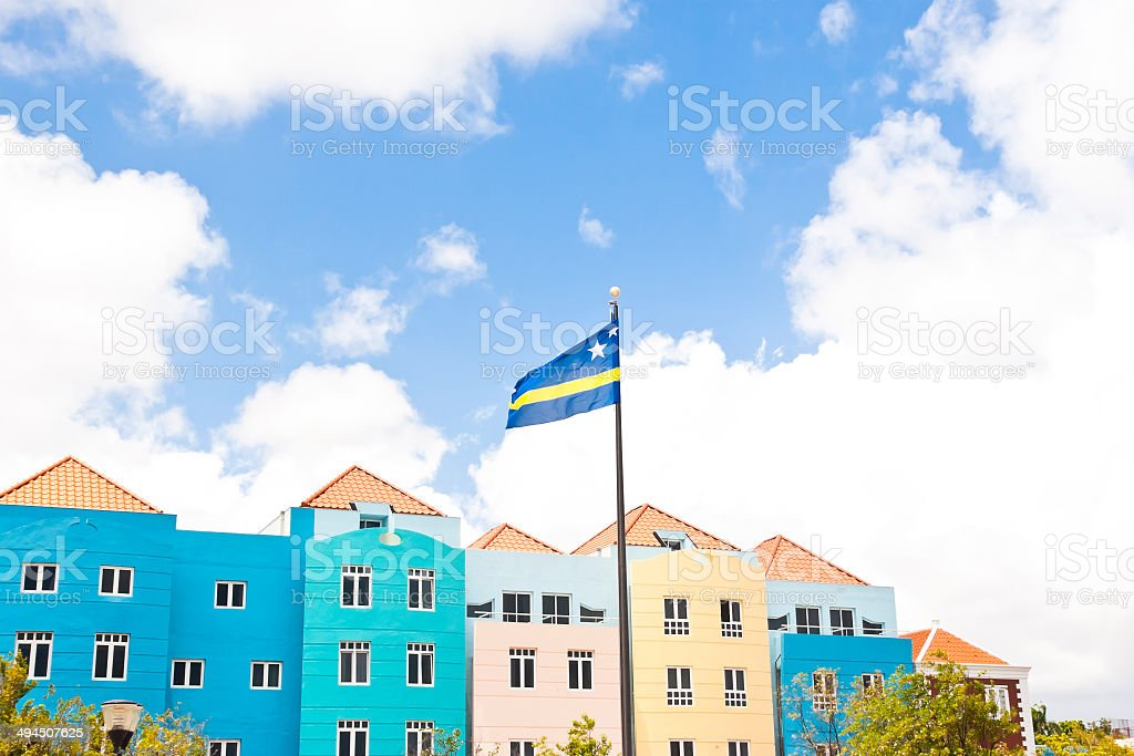 Colorful building facades with Curacao flag stock photo