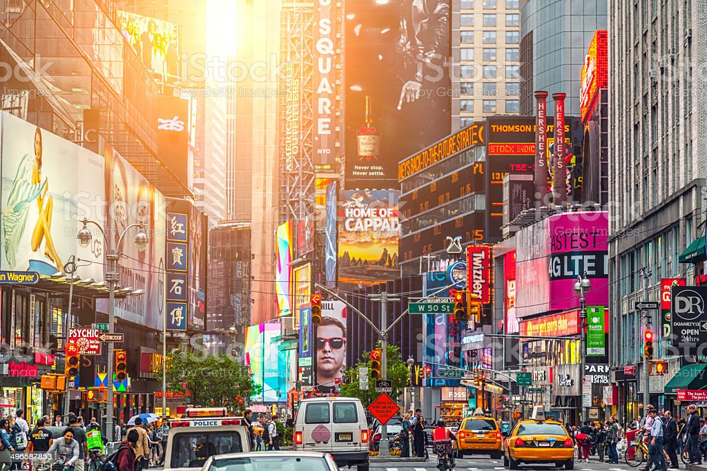 Colorful building signs and cars in Times Square stock photo